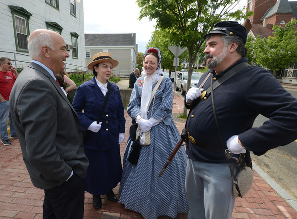 JIM VAIKNORAS/Staff photo Amesbury mayor Ken Gray talks with reinactors Bill and Liz Hallett and Liz's daughter Aileen Kelly before the start of Amesbury annual Memorial Day Parade.