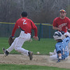 JIM VAIKNORAS/Staff photo Triton's Jason Tidmarsh steals second as the throw lands between Amesbury's Jared Dupre and Benjamin Cullen during their game at Triton in Byfield Saturday.
