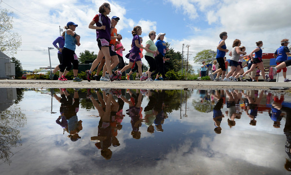 JIM VAIKNORAS/Staff photo Runners take off at  the Run for the Roses in Salisbury Saturday.