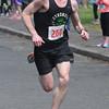 JIM VAIKNORAS/Staff photo Spring Fever 5K Run Winner Mah Valli finishes at the Bresnahan School in Newburyport Sunday.