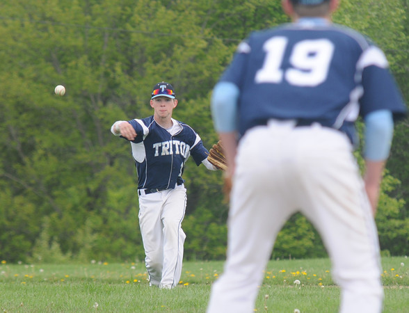 JIM VAIKNORAS/Staff photo Triton's Justin Cashman makes a play from short during the Viking Game against North Reading in Byfield Monday.