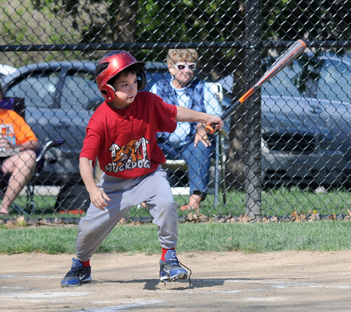JIM VAIKNORAS/Staff photo Ben Cook of the  Muddogs gets a hit against the Riverdogs during their game at Pioneer Park Sunday in Newburyport.