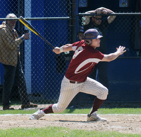 JIM VAIKNORAS/Staff photo Travis Wile hits a 2 run single in extra inning to put Newburyport ahead during their championship game against Georgetown in the annual Bert Spofford Baseball Tournament at Georgetown Sunday. The Clippers hung on to win the game 8-5.