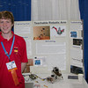 Newburyport's Mark Landergan with his science project , a teachable robotic arm.