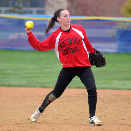 JIM VAIKNORAS/Staff photo Amesbury's Lauren Fedorchak throws out a runner during the Indian's game at Triton in Byfield Friday.