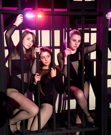 JIM VAIKNORAS/Staff photo Lizzy Keery as Annie , Emily Gilligan as Mona and Lindsay Howard as Liz in the Newburyport high production of Chicago.