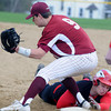 JIM VAIKNORAS/Staff photo Newburyport's Travis Wile can't get the tag down as Amesbury's Spencer Fournier dives back to first on a pickoff play during their game at Amesbury Sunday.
