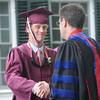 JIM VAIKNORAS/Staff photo Patrick Farrell of Newburyport shakes hands with headmaster Peter Quimby at The Governor's Academy's Commencement at the school in Byfield Sunday.