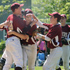 JIM VAIKNORAS/Staff photo Teammates congradulate Scott Webster after he went nine innings in the championship game against Georgetown in the annual Bert Spofford Baseball Tournament at Georgetown Sunday. The Clipper won the game 8-5.