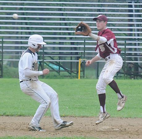 JIM VAIKNORAS/Staff photo  Pentucket's DJ Englke get back to second just ahead of the throw to Newburyport's Caleb Stottduring their game at Pentucket High in West Newbury.