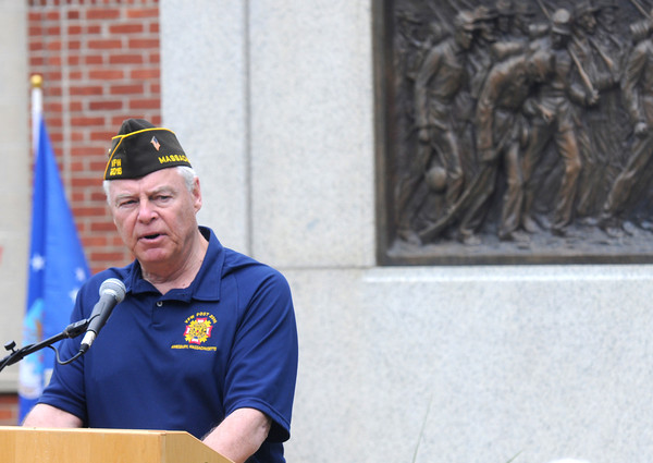 JIM VAIKNORAS/Staff photo Veteran's Agent Kevin Hunt speaks at the Re-Dedication of the Amesbury Doughboy statue at Amesbury Middle School Sunday.