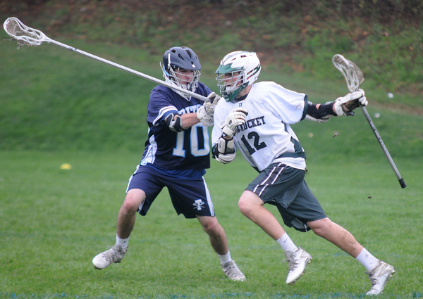 JIM VAIKNORAS/Staff photo  Triton's Kevin Clark puts pressure on Pentucket's Nick Arcadipane during their game at Pipestave Hill in West Newbury.