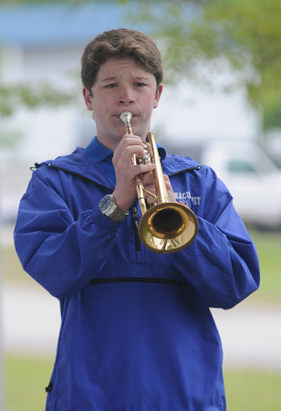 JIM VAIKNORAS/Staff photo John Wilusz of the Winnacunett band plays taps  at the Seabrook Memorial Day ceremony Sunday morning.