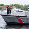 JIM VAIKNORAS/Staff photo Members of the US Coast Guard salute after tossing a wreath in the Merrimack River at the annual Newburyport Memorial Day service.