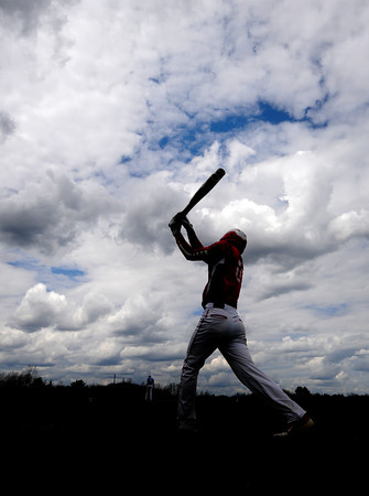JIM VAIKNORAS/Staff photo Amesbury's John Pesci swings 2 bat while on deck during the Idians game at Triton in Byfield Saturday.
