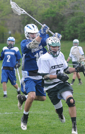 JIM VAIKNORAS/Staff photo Pentucket's Nick Zaia breaks away from Georgetown's Jared Warren during their game at Pipestave hill in West Newburyport.