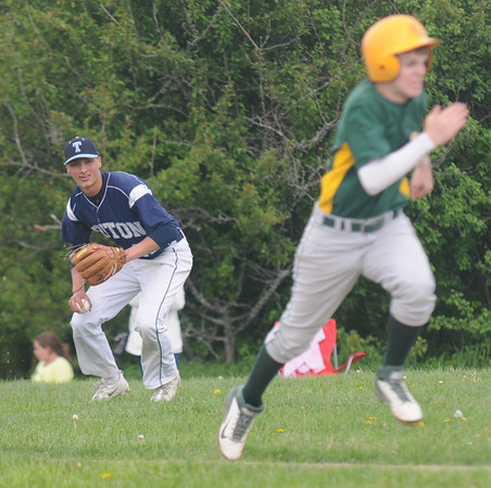 JIM VAIKNORAS/Staff photo  Triton's Bradley Whitman throws out a runner at first during the Viking Game against North Reading in Byfield Monday.