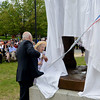 JIM VAIKNORAS/Staff photo Amesbury Mayor Ken Grey and Frances Justin , who attended the original dedication in 1929, unveils the restored statue at the Re-Dedication of the Amesbury Doughboy statue at Amesbury Middle School Sunday.