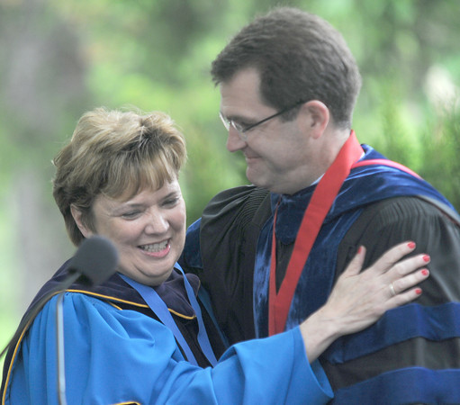 JIM VAIKNORAS/Staff photo Speaker Dr Lynn Pasquerella hugs headmaster Peter Quimby at The Governor's Academy's Commencement at the school in Byfield Sunday.