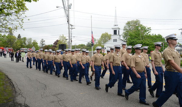 JIM VAIKNORAS/Staff photo Members of the Marine Jr ROTC make their way down Walton Road Sunday morning in the annual Seabook Memorial Day Parade .