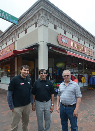 JIM VAIKNORAS/Staff photo New Richday owners Amit and Bob Patel with former owner John Magro infront of the State Street store in Newburyport.