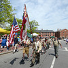 JIM VAIKNORAS/Staff photo The Newburyport Boy Scouts march up State Street during the annual Newburyport Memorial Day parade.