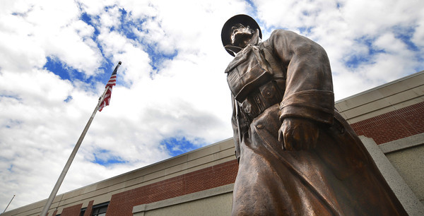 JIM VAIKNORAS/Staff The newly restored Doughboy statue at the Re-Dedication at Amesbury Middle School Sunday.