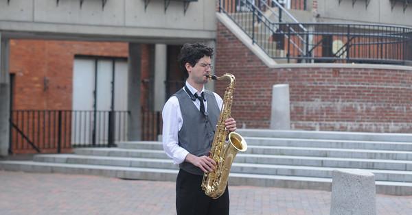 JIM VAIKNORAS/Staff photo Jared Holaday of Lowell plays sax on Inn Street Friday afternoon.