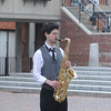 JIM VAIKNORAS/Staff photo Jared Holaday of Lowell plays sax on Inn Street Friday afternoon.