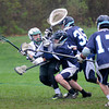 JIM VAIKNORAS/Staff photo  Pentucket's Connor Beaton is pressured by a host of Triton defenders as he scores during their game at Pipestave Hill in West Newbury.
