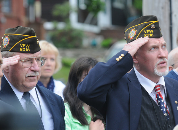"JIM VAIKNORAS/Staff photo Amesbury Veterans' Memorial Restoration Co-Chairs Gregg ""Ski"" Iwarski and Paul ""Jancy"" Jancewicz salute during  the National Anthem at the Re-Dedication of the Amesbury Doughboy statue at Amesbury Middle School Sunday."