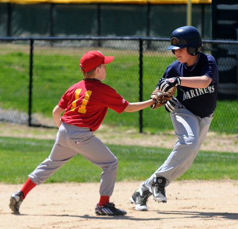 JIM VAIKNoRAS/Staff photo  Sam Elias  of the Mariners is tagged out by the Cardinals Ibo Sava during their game at Pioneer Park Sunday in Newburyport.