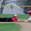 JIM VAIKNORAS/Staff photo  Amesbury's Mac Short dives safely back to second a Newburyport'sCaleb Stott fields the throw on a pickoff play during their game at Amesbury Sunday.