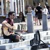 JIM VAIKNORAS/Staff photo  Luke Piercy of Amesbury plays guitar for tips on Inn Street in Newburyport Sunday.