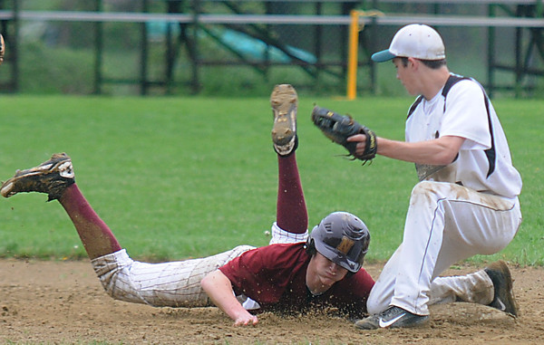 JIM VAIKNORAS/Staff photo Newburyport's Ben Vetura slides safely under the tag of Pentucket's Kiernan Haley during their game at Pentucket High in West Newbury.