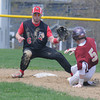 JIM VAIKNORAS/Staff photo Newburyport's Caleb Stott slides safely into second as the ball gets past Amesbury's Benjamin Cullen during their game at Amesbury Sunday.