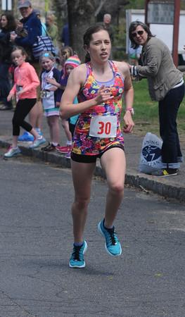 JIM VAIKNORAS/Staff photo Spring Fever 5K Run Winner Rosie Donegan finishes at the Bresnahan School in Newburyport Sunday.