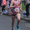 JIM VAIKNORAS/Staff photo Spring Fever 5K Run Winner Rosie Donegan finishes at the Bresnahan School in Newburyport Sunday.