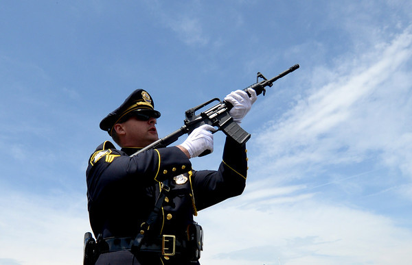 JIM VAIKNORAS/Staff photo Sgt. Matthew Simons of the Newburyport Police Dept fire a salute at the annual Newburyport Memorial Day service.
