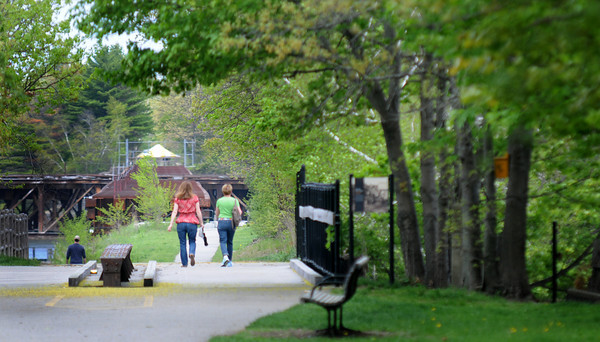 JIM VAIKNORAS/Staff photo Two women walk down the Rail Trail in Newburyport Friday morning.