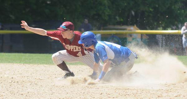 JIM VAIKNORAS/Staff photo Georgetown's Calvin Woolery-Price is tagged out by Newburyport's Travis O'Brien as he tries to steal second during their championship game against Georgetown in the annual Bert Spofford Baseball Tournament at Georgetown Sunday. The Clippers won the game 8-5.