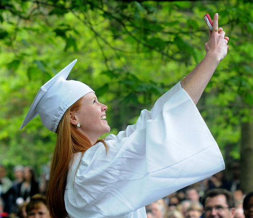 JIM VAIKNORAS/Staff photo Lucy Purinton of Newburyport takes a selfie before giving the Benediction at The Governor's Academy's Commencement at the school in Byfield Sunday.