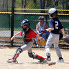 JIM VAIKNORAS/Staff photo William Thureson of the Mariners just gets past the tag of the Cardinals Dreese Fadil during their game at Pioneer Park Sunday in Newburyport.