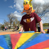 JIM VAIKNORAS/Staff photo Gabby Monroe, 11, spins the Wheel of Fortune at the Newburyport Youth Services Duck Derby at the Mall in Newburyport Sunday.