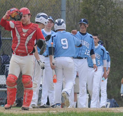 JIM VAIKNORAS/Staff photo  Amesbury's Mac Short puts his mask back on as Triton's William Micah is greated by his teammates after scoring during their game at Triton in Byfield Saturday.