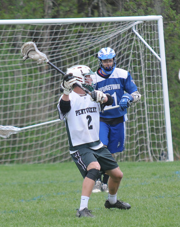 JIM VAIKNORAS/Staff photo Pentucket's Jeff Porter with a shot on net against Georgetown during their game at Pipestave hill in West Newburyport.