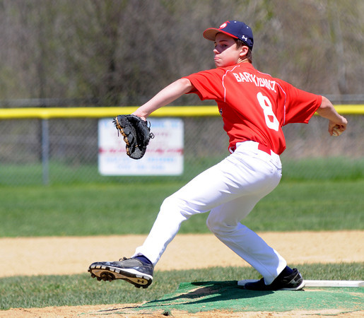 JIM VAIKNORAS/Staff photo Walker Barkiewicz pitches for the Hurricanes against the Viking at teh Cashman School in Amesbury Sunday morning.