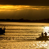 JIM VAIKNORAS/Staff photo Two fishermen head out toward Joppa in Newburyport early Sunday morning.