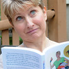"JIM VAIKNORAS/Staff photo  Nancy Crochiere with her book "" THe Mother Load""."