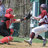 JIM VAIKNORAS/Staff photo  Amesbury's Mac Short fields the throw home before tagging out Newburyport's Ryan Furlong on a double steal play during their game at Amesbury Sunday.